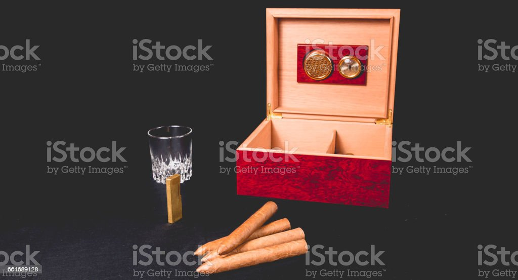Cigar box on black background and lighter stock photo