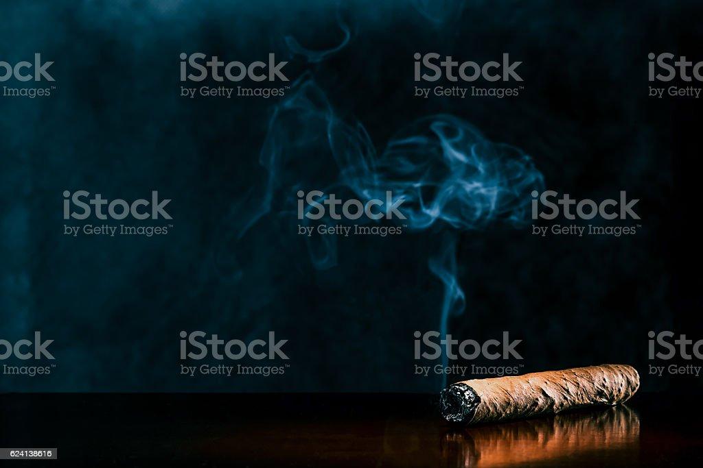 Cigar on dark background stock photo