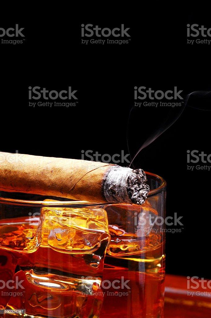 Cigar on Whiskey stock photo