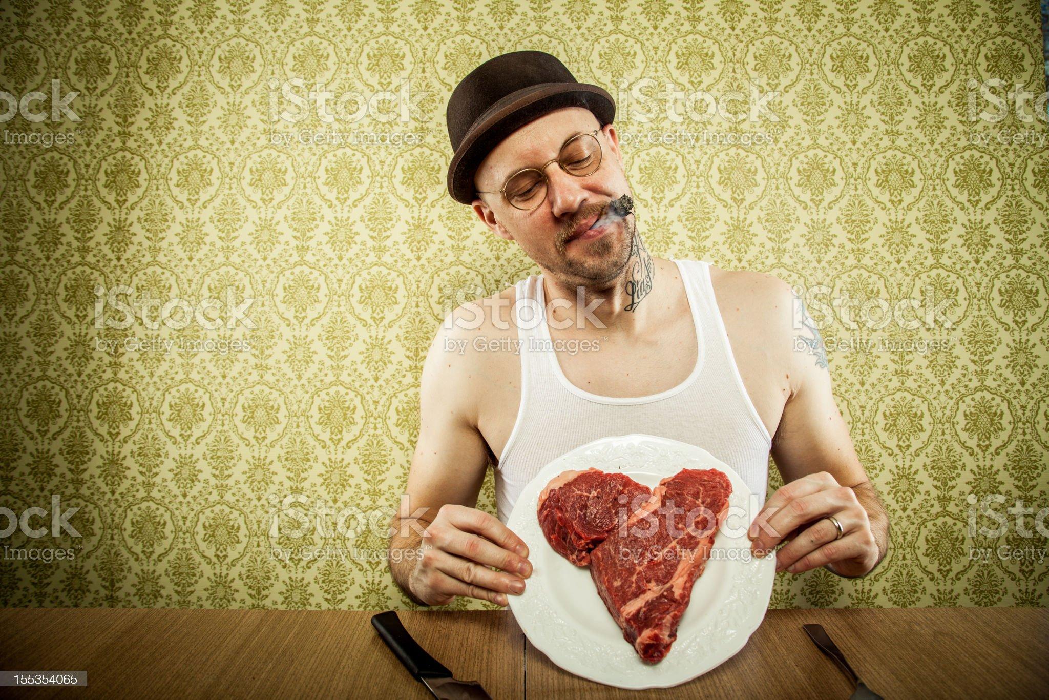 Cigar Smoking Man Holding a Heart Shaped Steak royalty-free stock photo