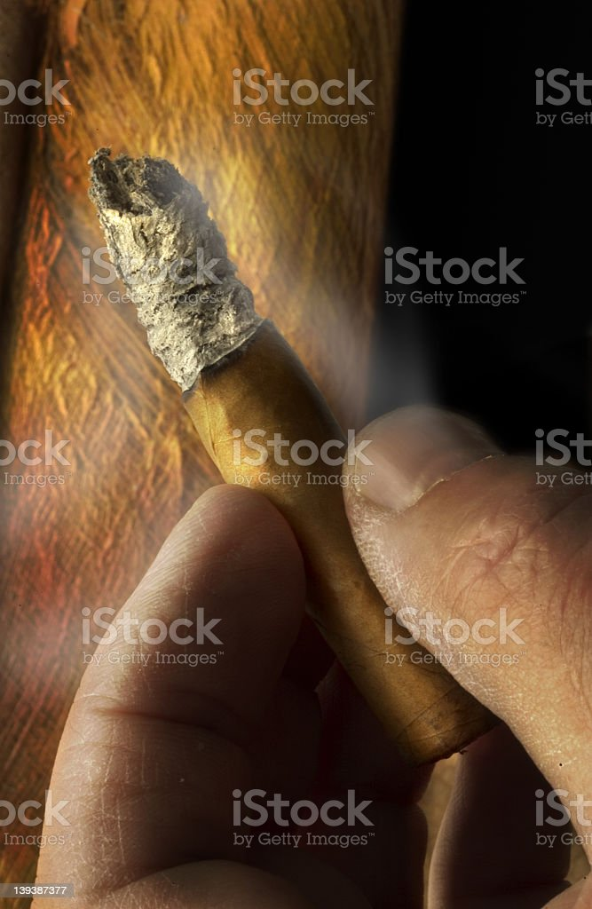 cigar with cracked hand royalty-free stock photo