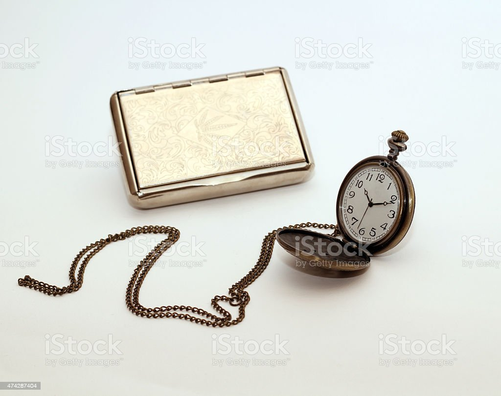 cigaratte case and chain watch stock photo