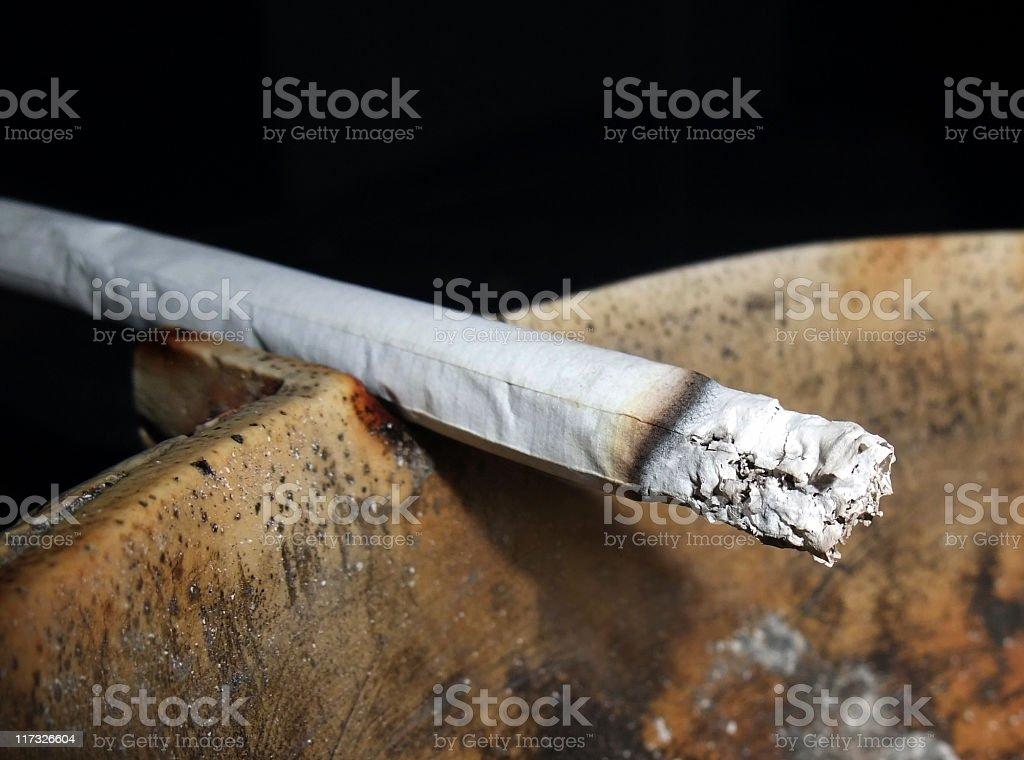 cigarette and ashtray closeup stock photo