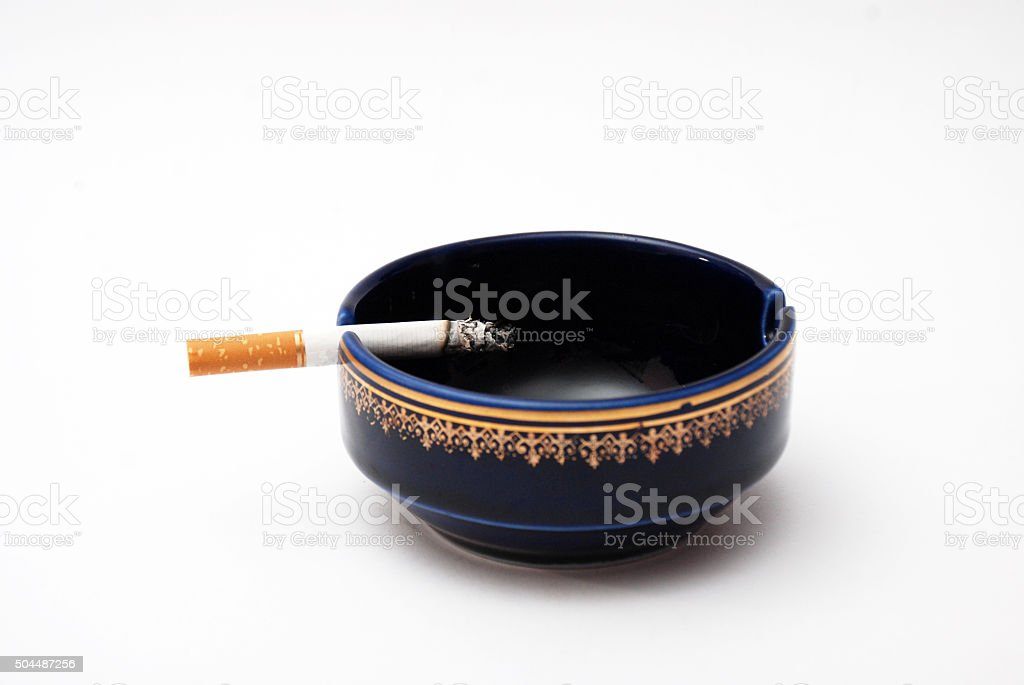 cigarette and blue ash tray stock photo