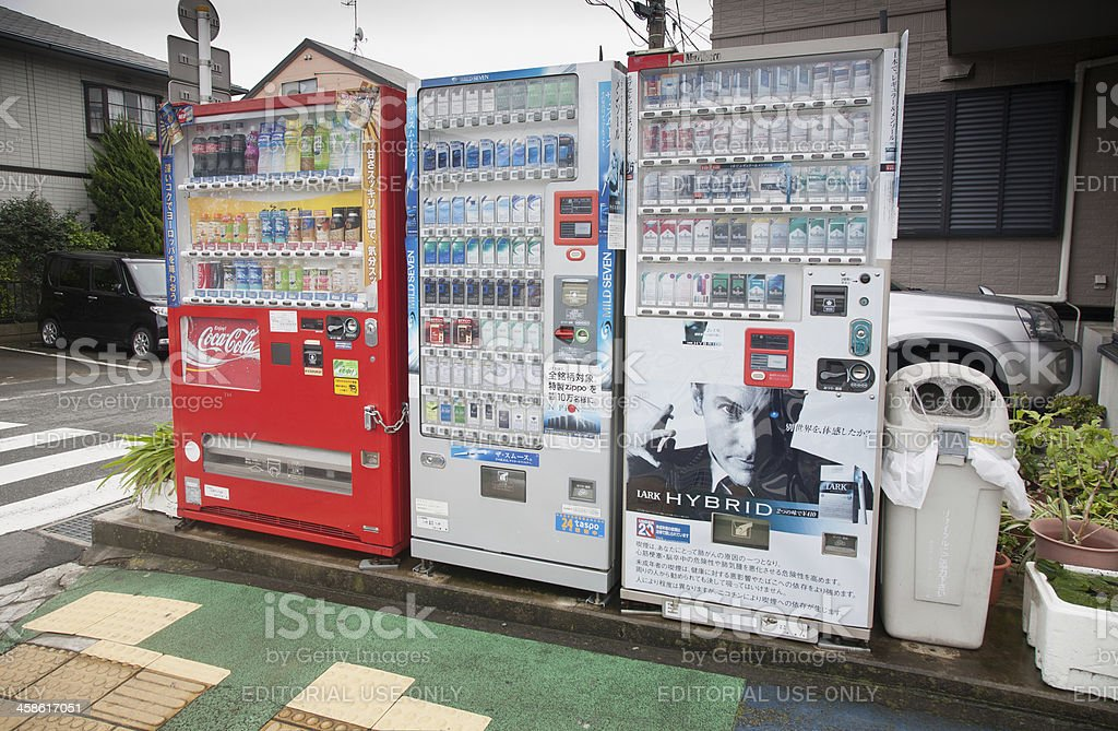 Cigarette and drinks vending machines in Japan. stock photo