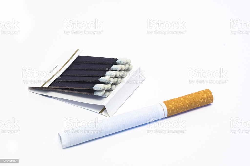 Cigarette and Matches royalty-free stock photo