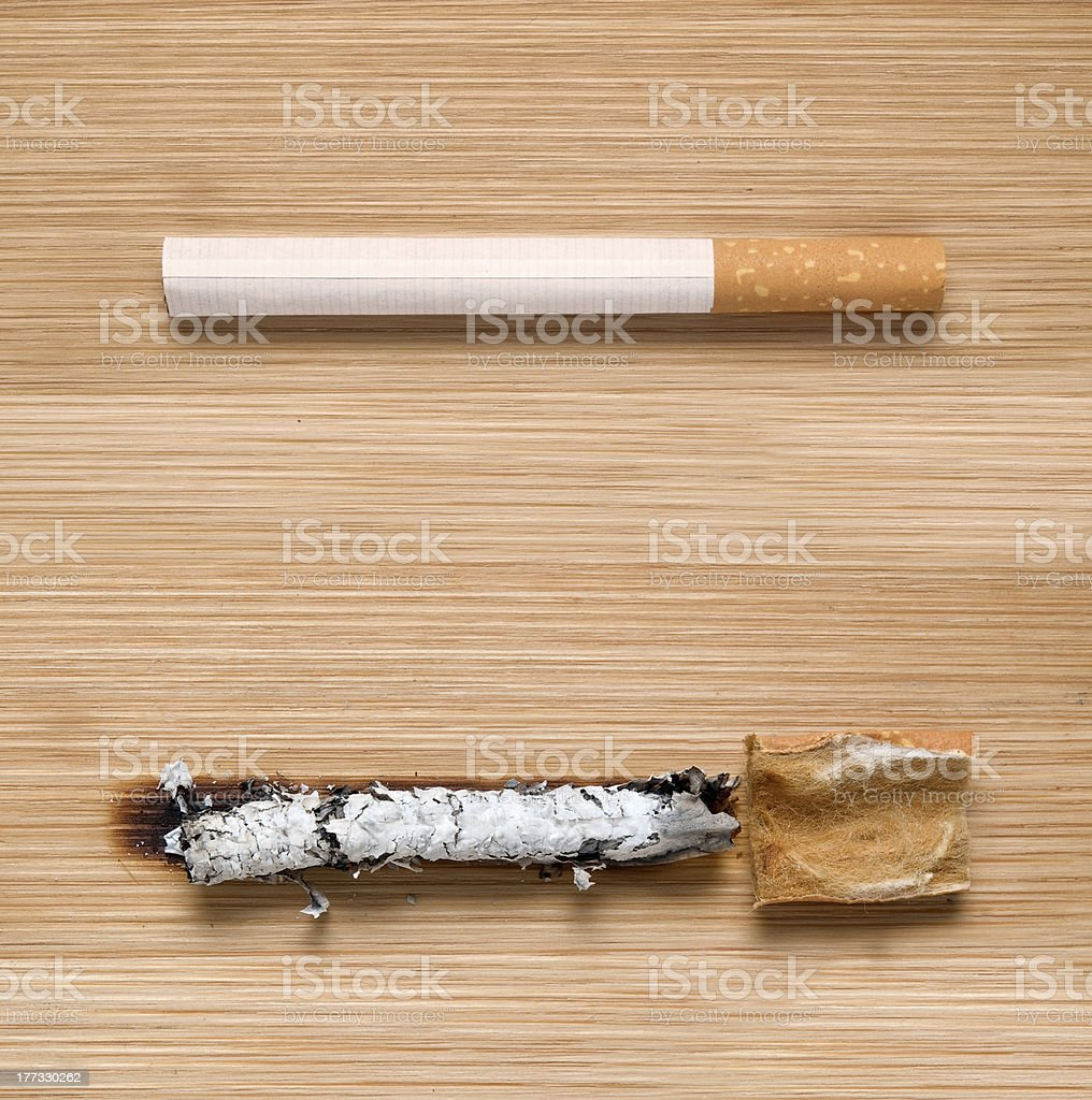 cigarette before and after being smoked royalty-free stock photo