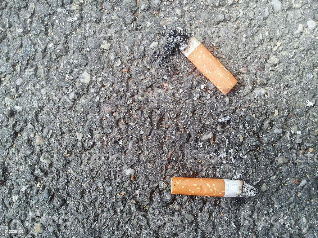 Cigarette butt background stock photo