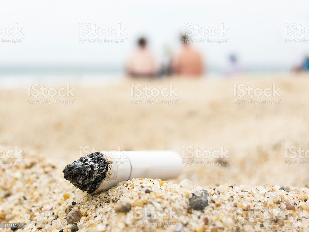 Cigarette butt on abeach royalty-free stock photo