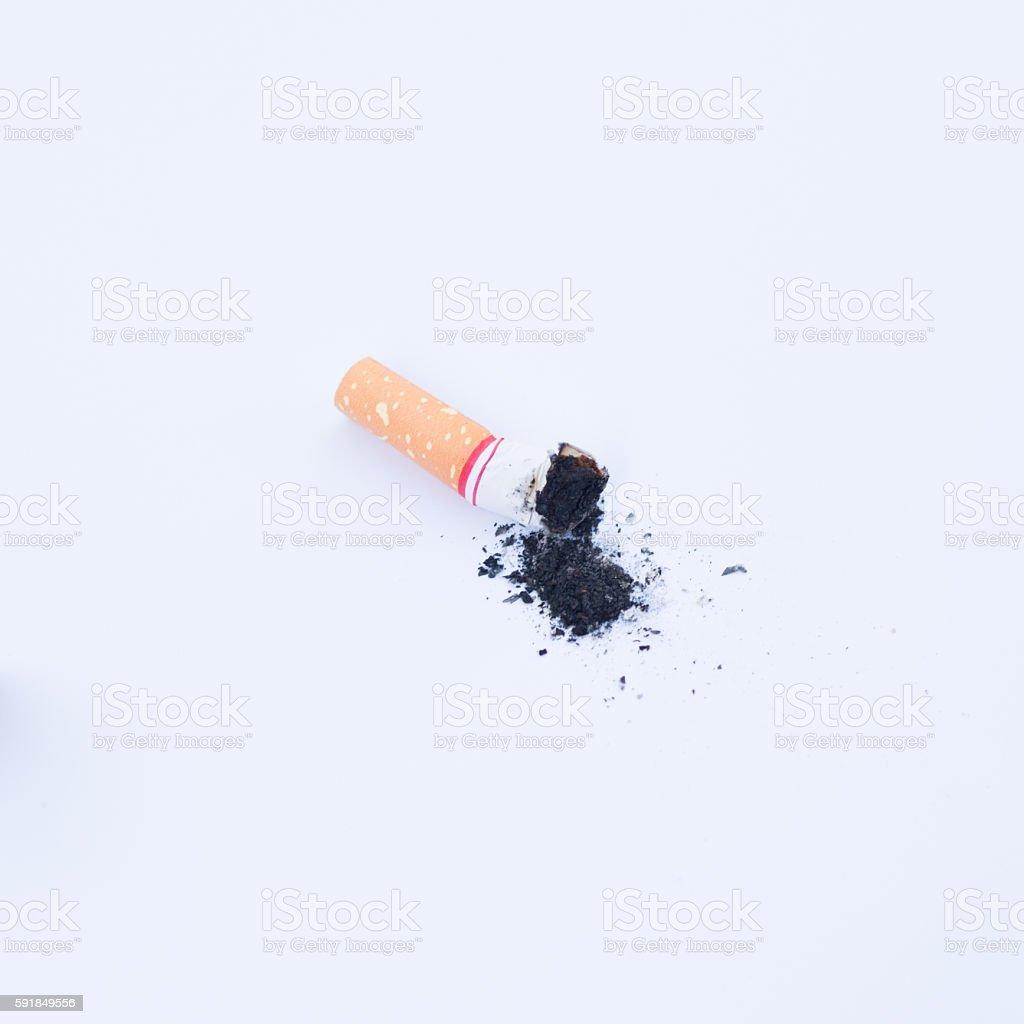 Cigarette butt on white background. stock photo