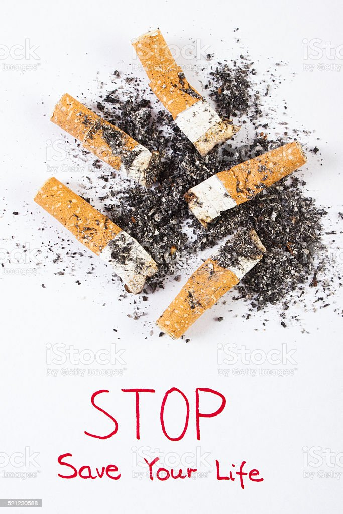 Cigarette butts and ash, stop tobacco save your life stock photo