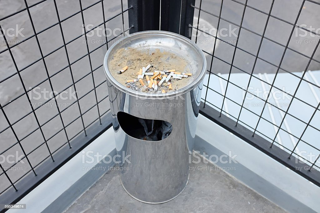 Cigarette butts discarded in ashtray stock photo