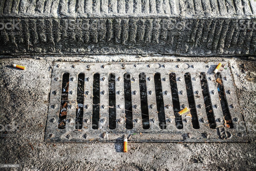 cigarette butts on a sewer in hdr stock photo