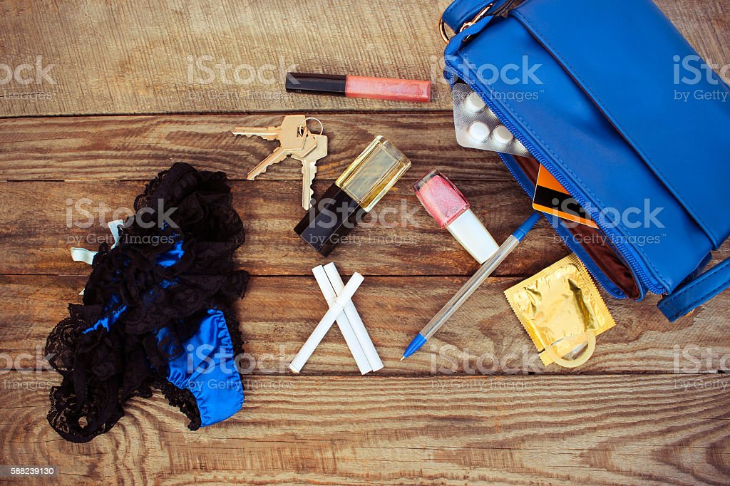 Cigarette, condom, panties, credit card, keys and cosmetics, handbags stock photo
