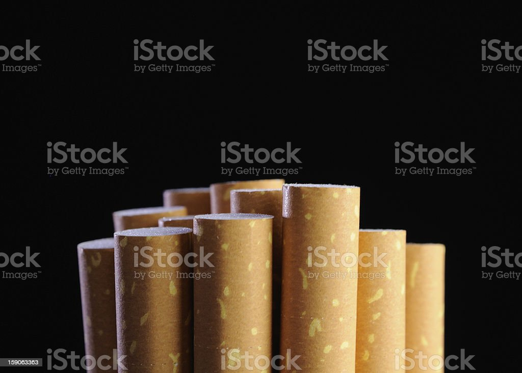 Cigarette Filters on Black Background royalty-free stock photo