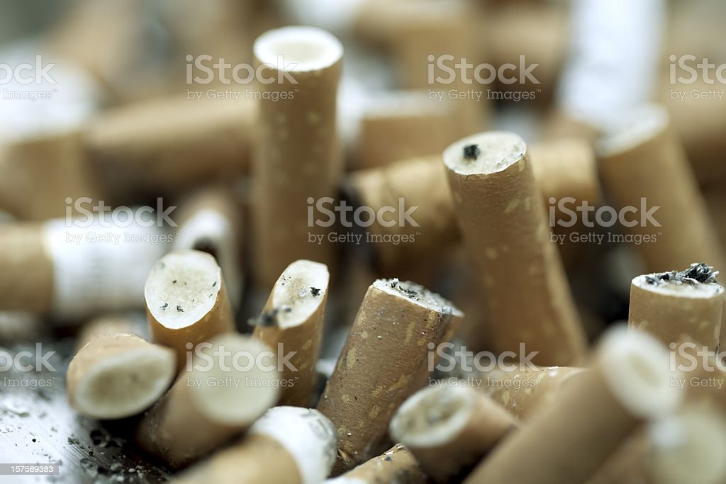 Cigarette graveyard stock photo