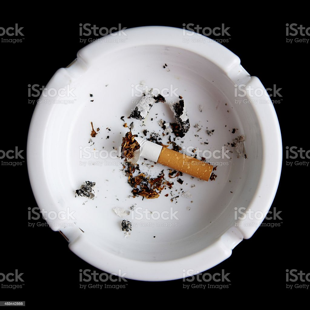 Cigarette in an ashtray on black royalty-free stock photo