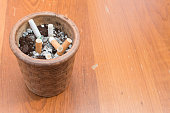 cigarette in ashtray on wooden background