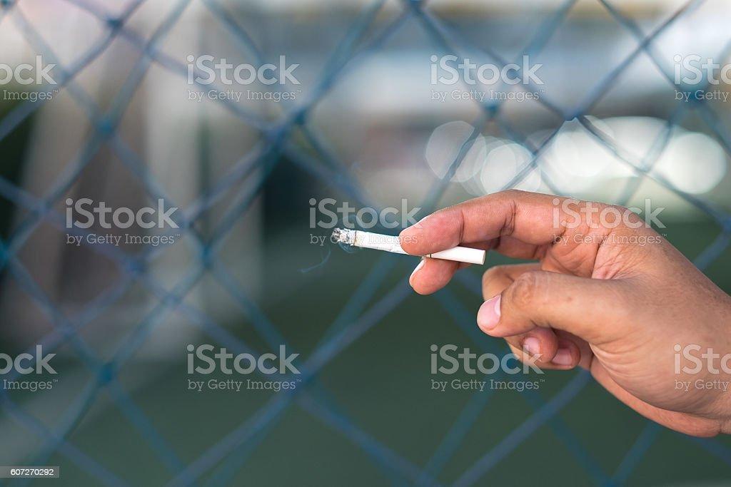 Cigarette in hand stock photo