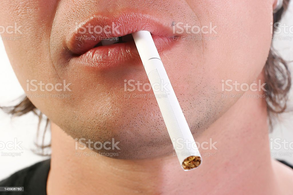 cigarette in mouth royalty-free stock photo