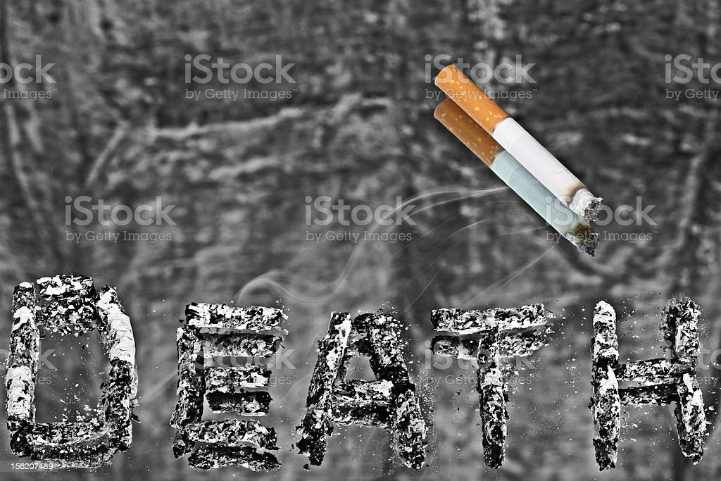 Cigarette is small killer. BW with color stub. royalty-free stock photo