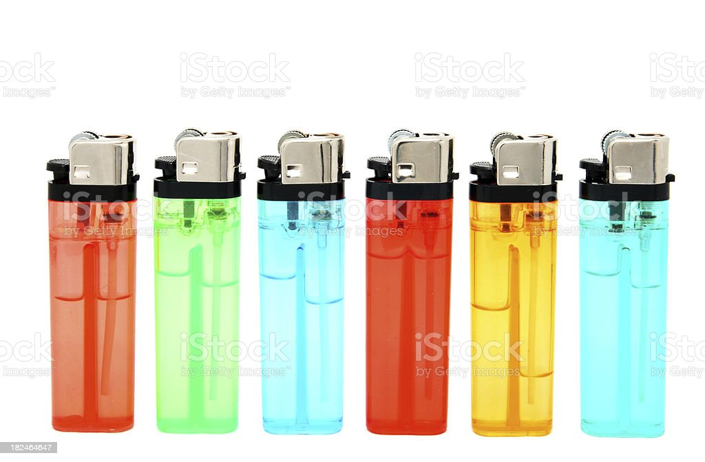 Cigarette Lighters in a Row on White Background stock photo