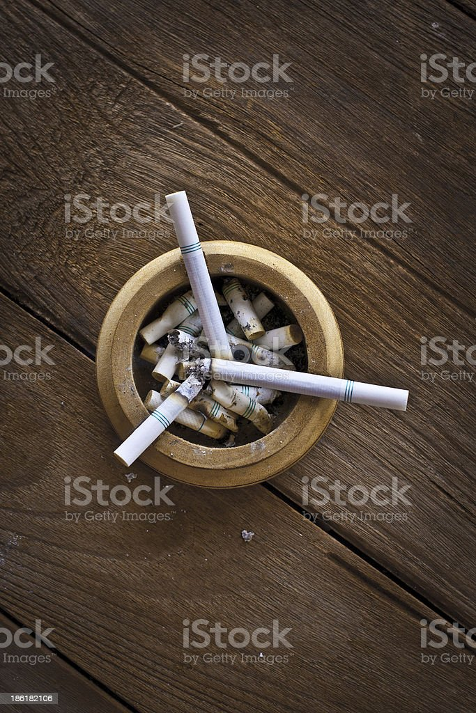 Cigarette on table royalty-free stock photo