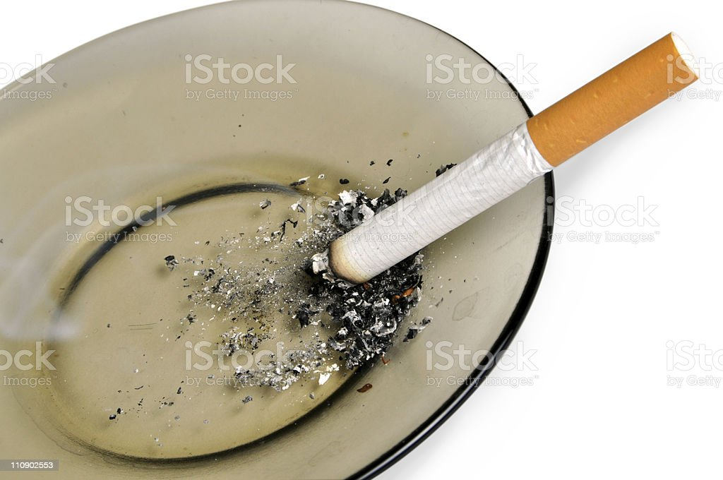 Cigarette on the ashtray isolated stock photo
