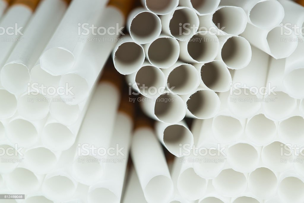 Cigarette paper ready to be filled with tobacco stock photo