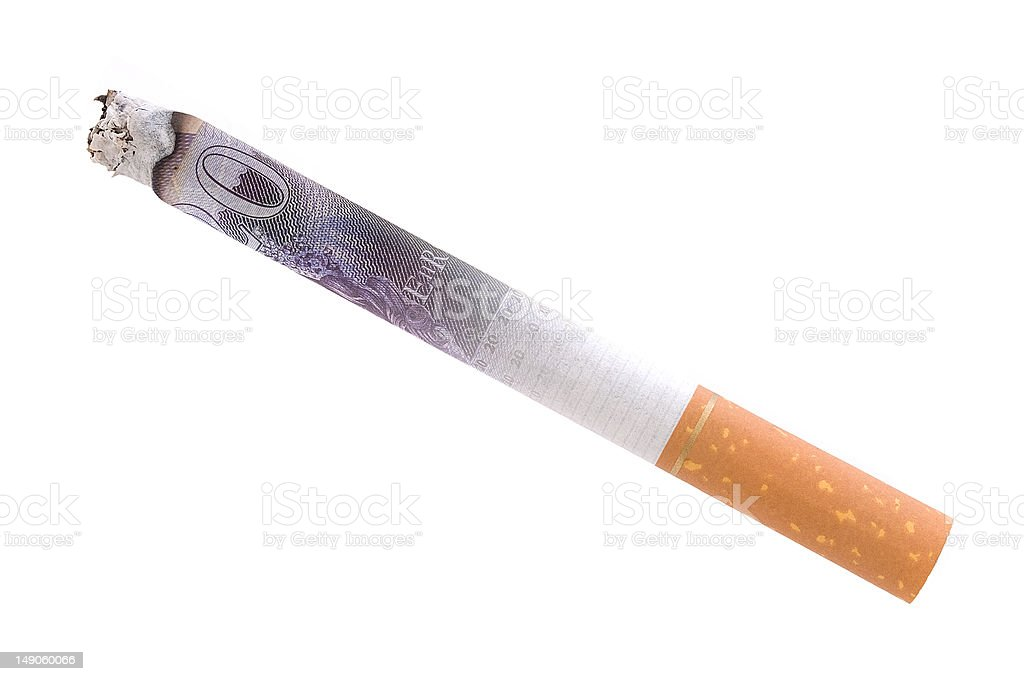 Cigarette representing burning money stock photo