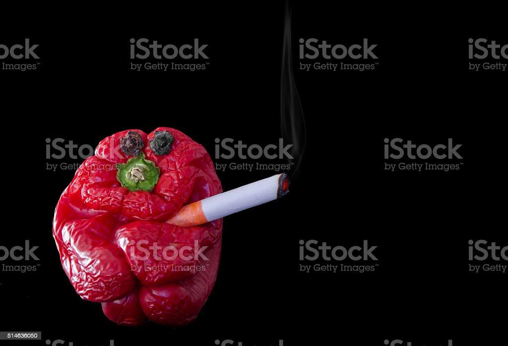 Cigarette Smoking Pepper Head stock photo