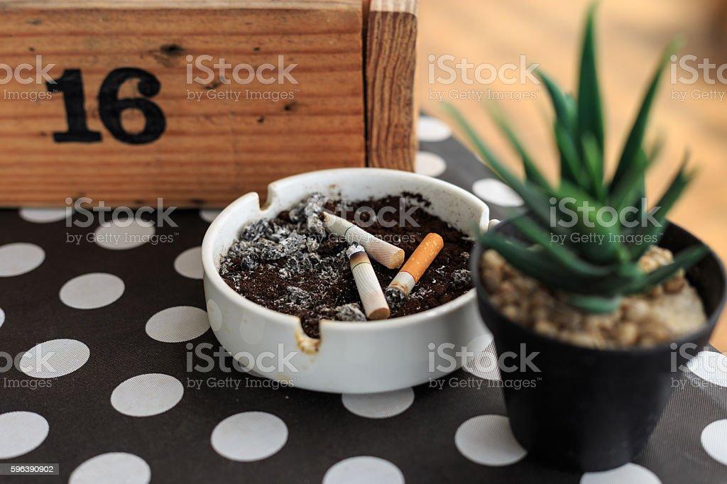 Cigarette stub on ashtray stock photo