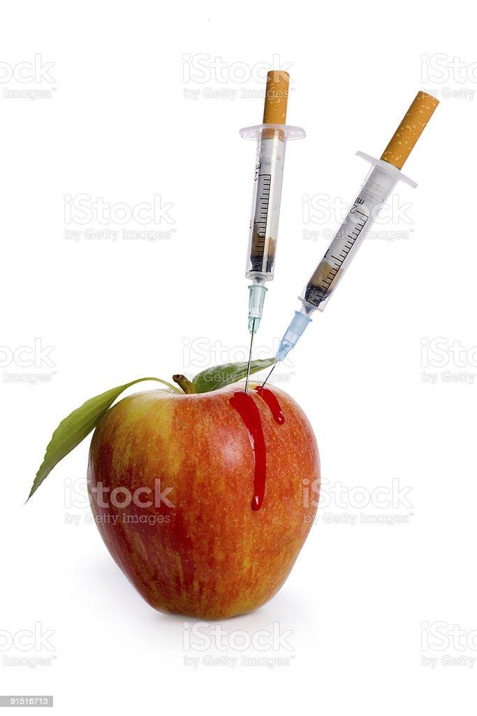 cigarette syringe in aple on white background royalty-free stock photo