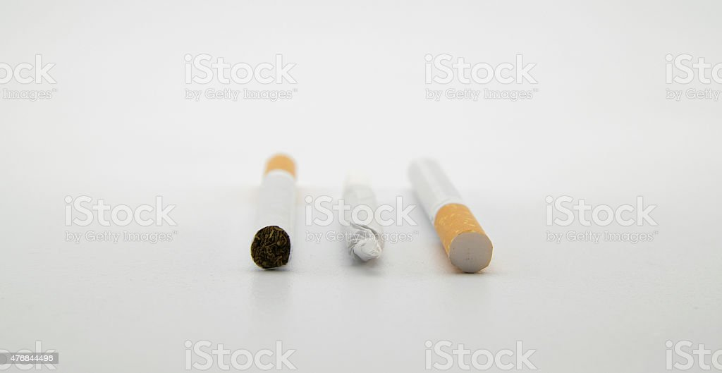 cigarettes and a hand-rolled cigarette stock photo