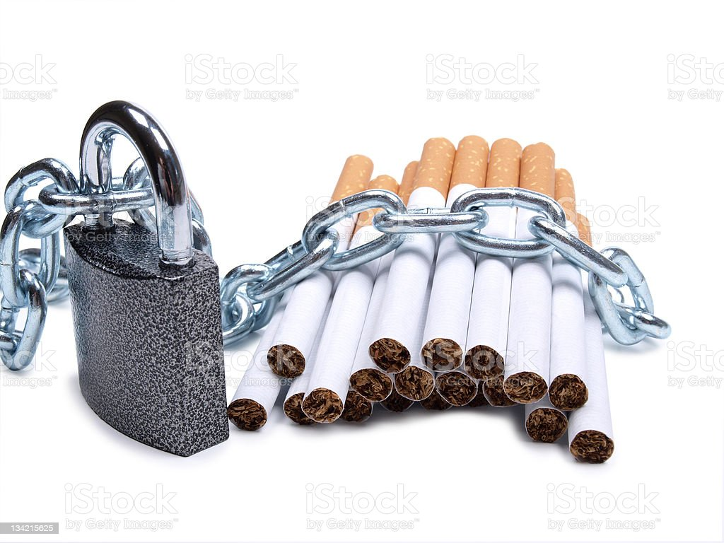 Cigarettes and a padlock stock photo