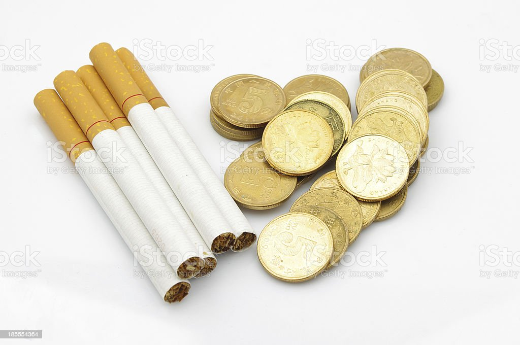 Cigarettes and money royalty-free stock photo