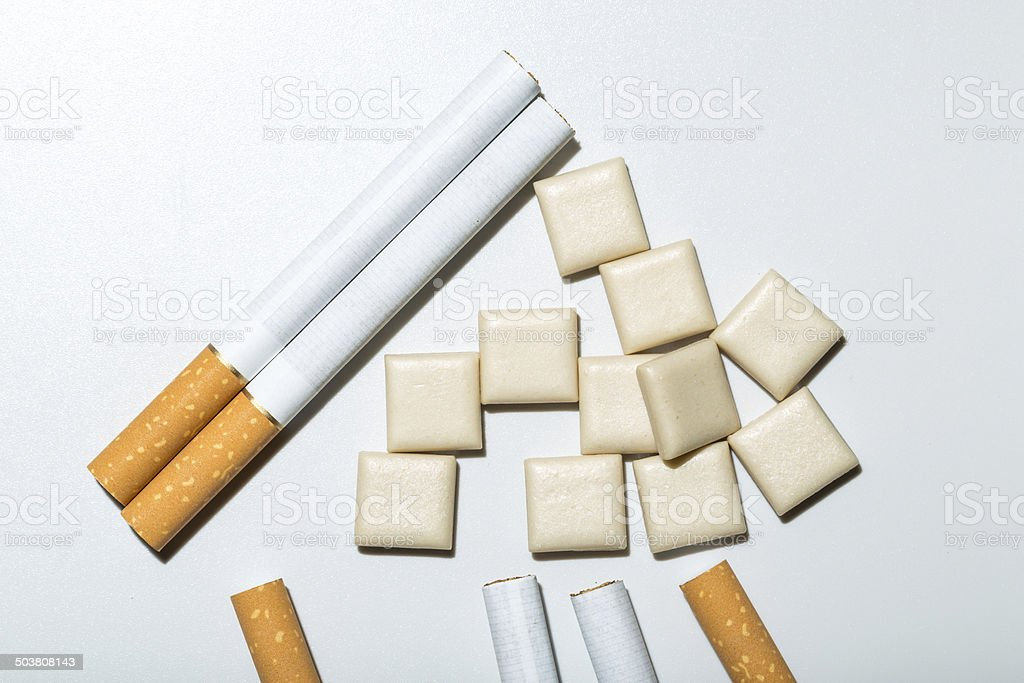 cigarettes and nicotine gum stock photo