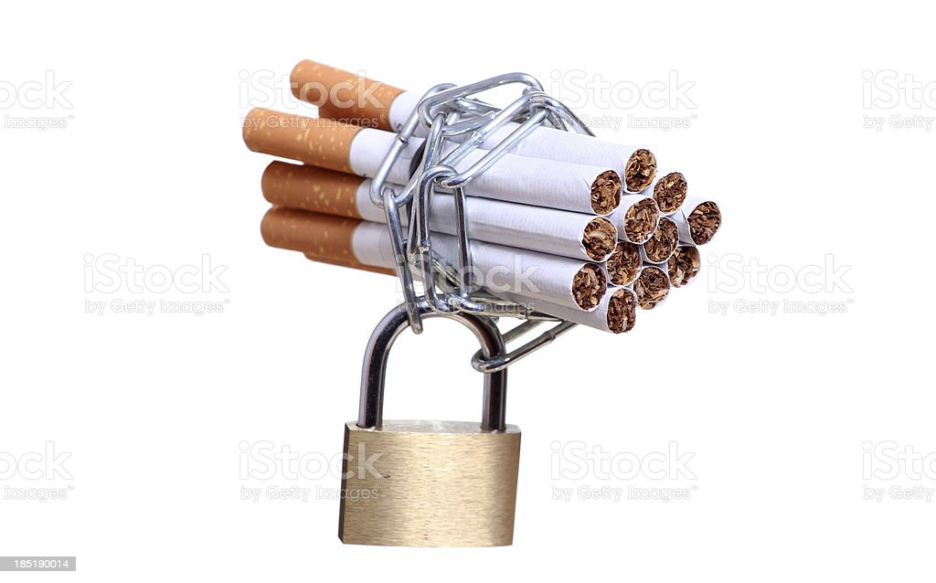 cigarettes captured with chain and padlock stock photo