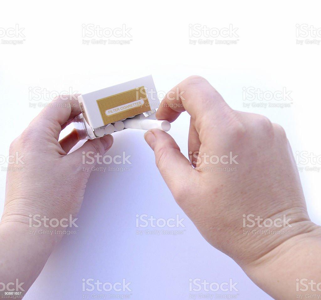 Cigarettes - Grabbing a smoke stock photo