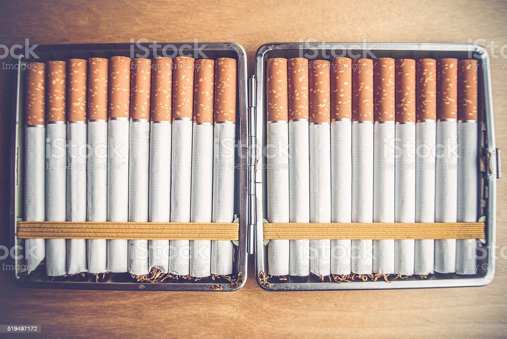 Cigarettes in a Cigarette Case stock photo