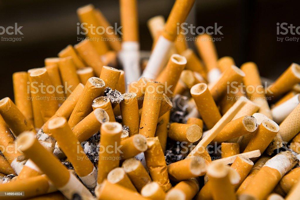 cigarettes in ashtray royalty-free stock photo