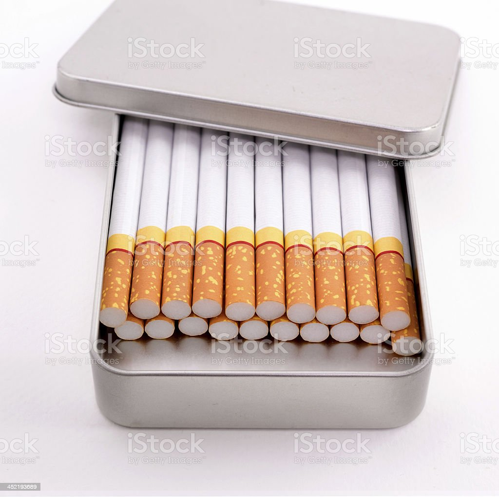 Cigarettes in metal box royalty-free stock photo