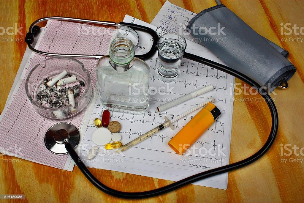 Cigarettes in the ashtray, vodka stock photo