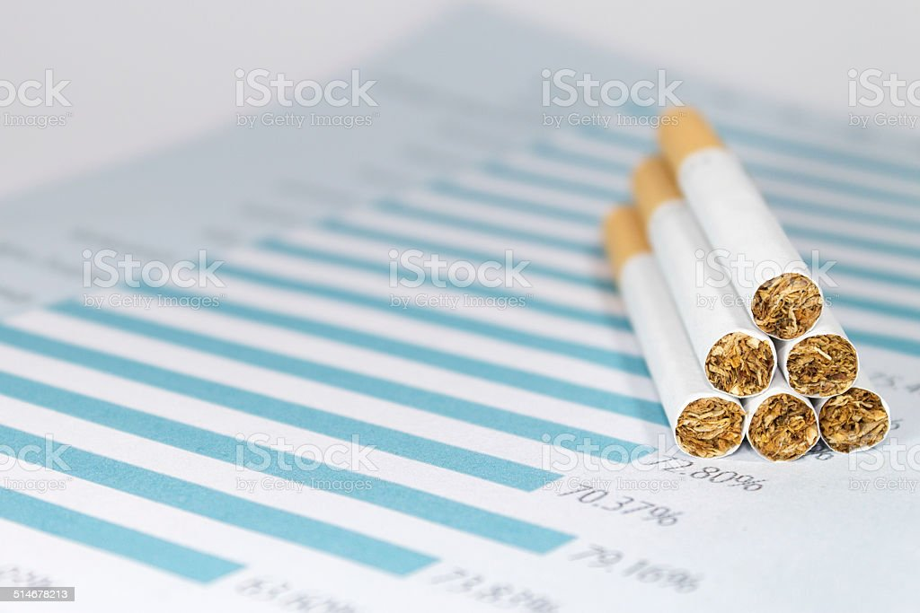 Cigarettes on Tax Chart stock photo