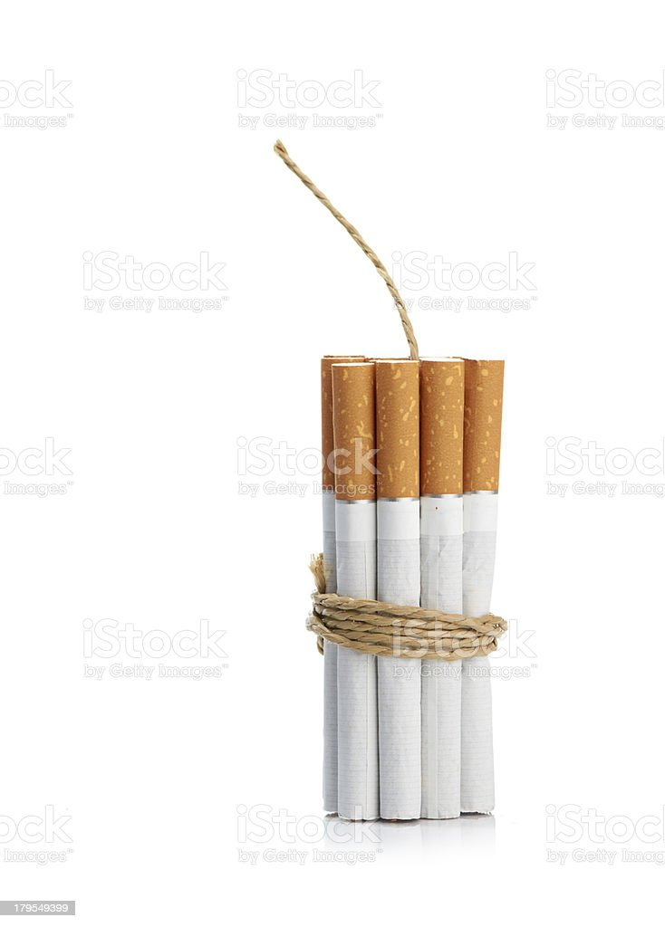 Cigarettes tied with rope and wick isolated on white royalty-free stock photo