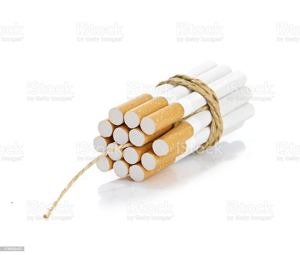 Cigarettes tied with rope and wick royalty-free stock photo