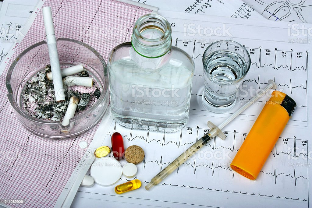 Cigarettes, vodka and drugs, pills stock photo