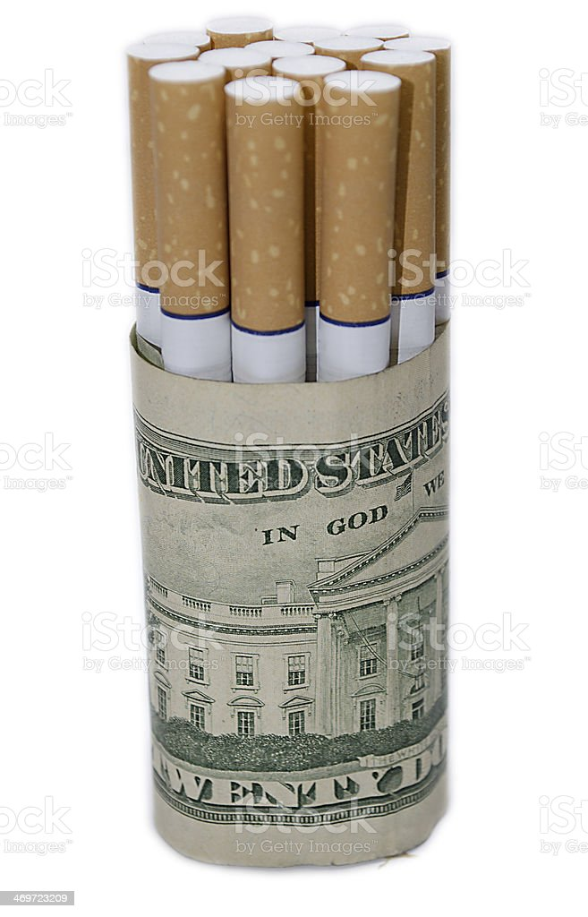 Cigarettes wrapped up in a dollar bill royalty-free stock photo