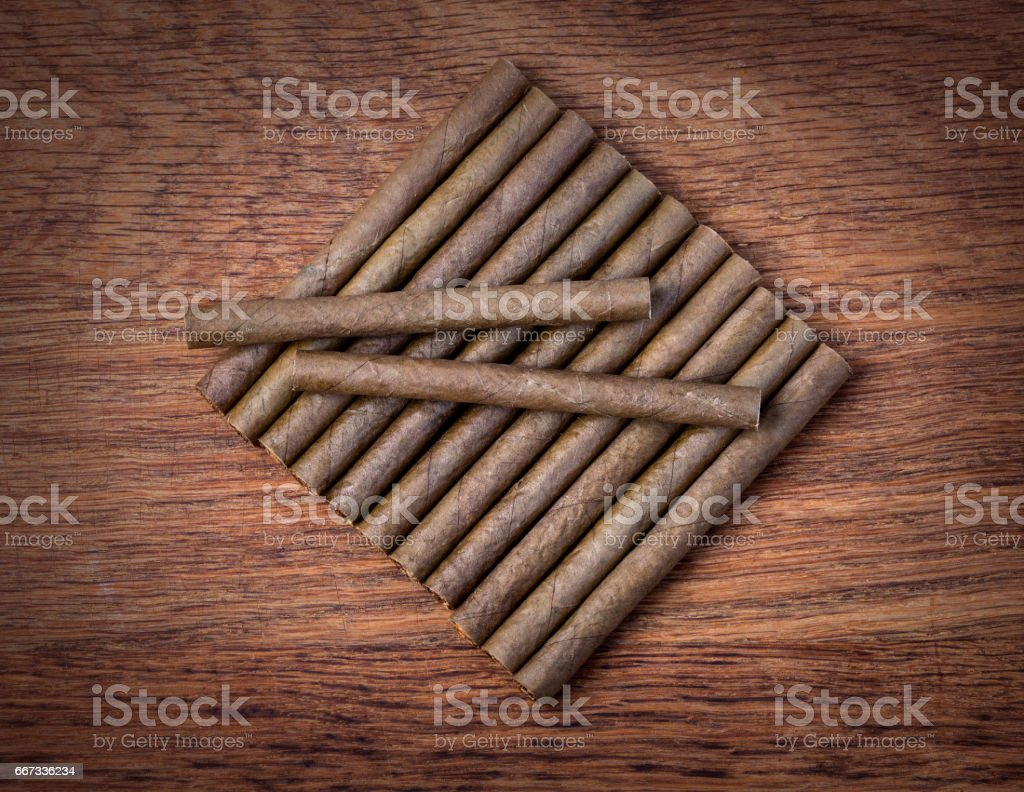 Cigarillo on wooden background stock photo