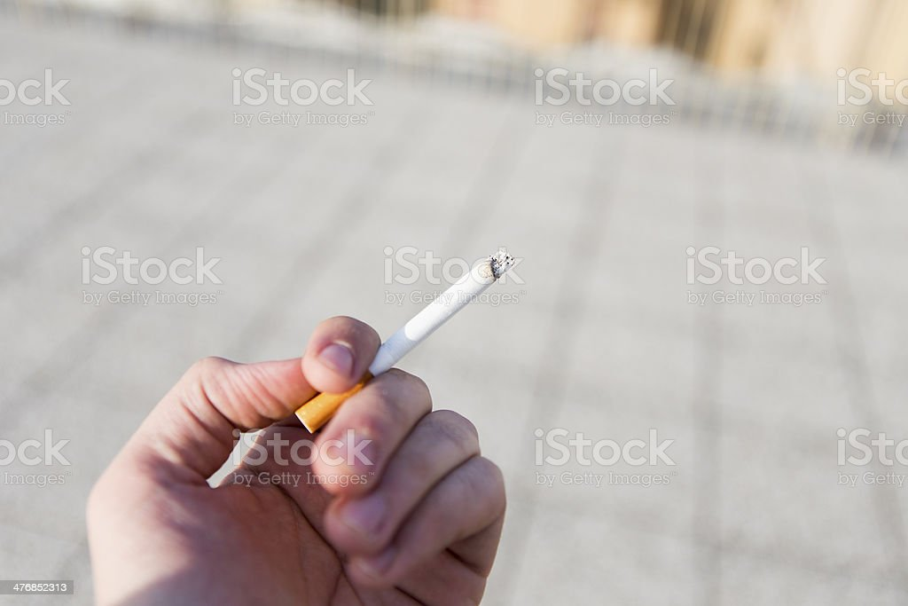 cigarrette in hand royalty-free stock photo